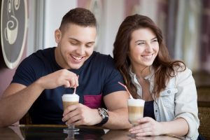 Couple drinking coffee and having fun date