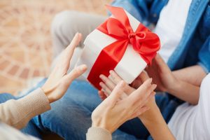 Female hands taking giftbox