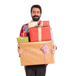 Businessman holding gifts